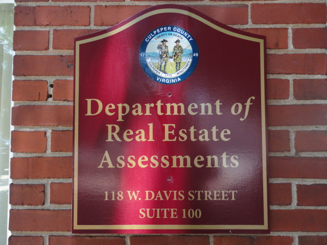 Real Estate Assements Sign